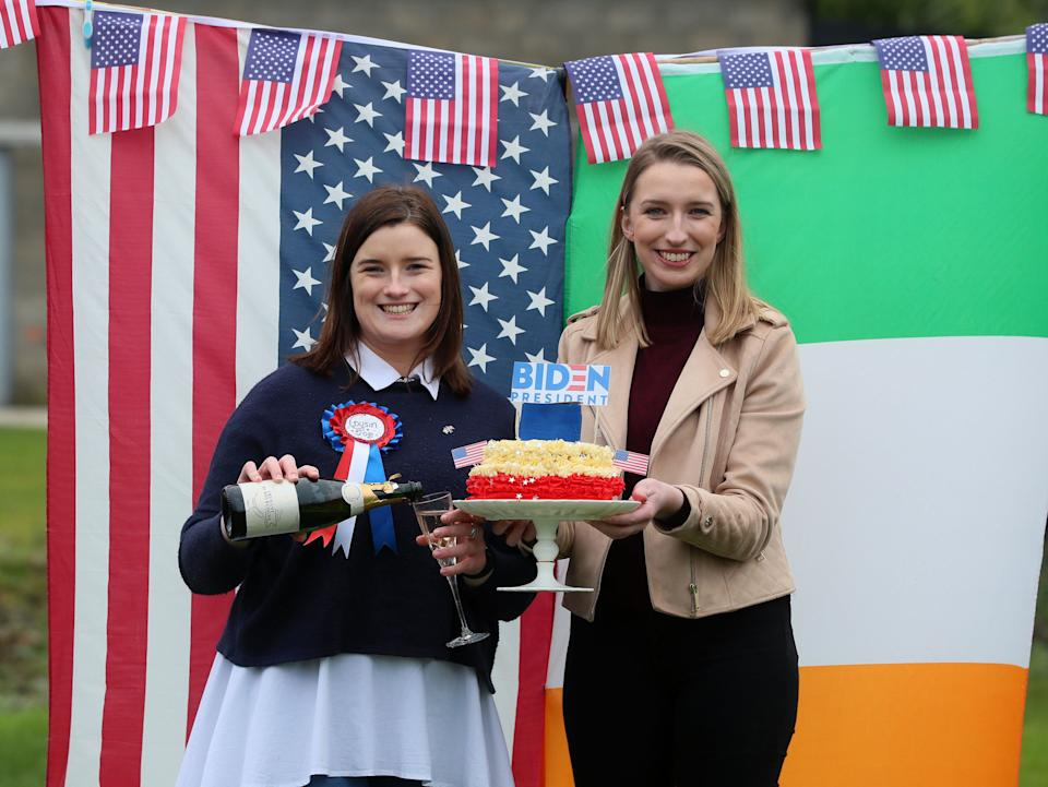 Fifth cousins of Mr Biden, Andrea McKevitt (left) and her sister Ciara, celebrated with champagne and homemade cake (PA)