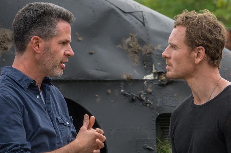 Simon Kinberg gives direction to Michael Fassbender on the set of <i>X-Men: Dark Phoenix</i>.