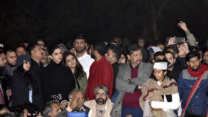 NEW DELHI, INDIA - JANUARY 7: Actor Deepika Padukone is seen at a gathering at JNU in solidarity with the students against Sunday's violence in the presence of JNUSU president Aishe Ghosh and CPI(M) leader Kanhaiya Kumar on January 7, 2020 in New Delhi, India. On Sunday, a mob of masked young people stormed the JNU campus in south Delhi and systematically targeted students in three hostels, unleashing mayhem with sticks, stones and iron rods, hitting inmates and breaking windows, furniture and personal belongings. At least 30 people including students and teachers injured. They also attacked a women's hostel. Left and ABVP are blamed each other for the attack. (Photo by Vipin Kumar/Hindustan Times via Getty Images)