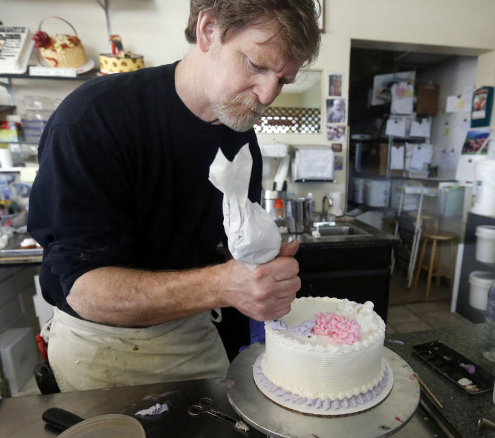 Image: Masterpiece Cakeshop owner Jack Phillips decorates a cake inside his store in Lakewood, Colo., on March 10, 2014. (Brennan Linsley / AP file)