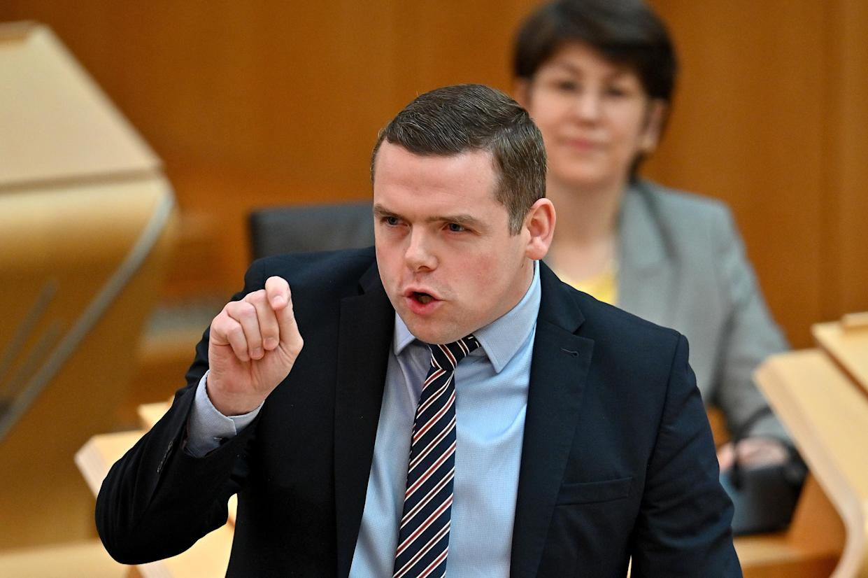 Scottish Conservative leader Douglas Ross pressed the First Minister on her plans (Jeff J Mitchell/PA)