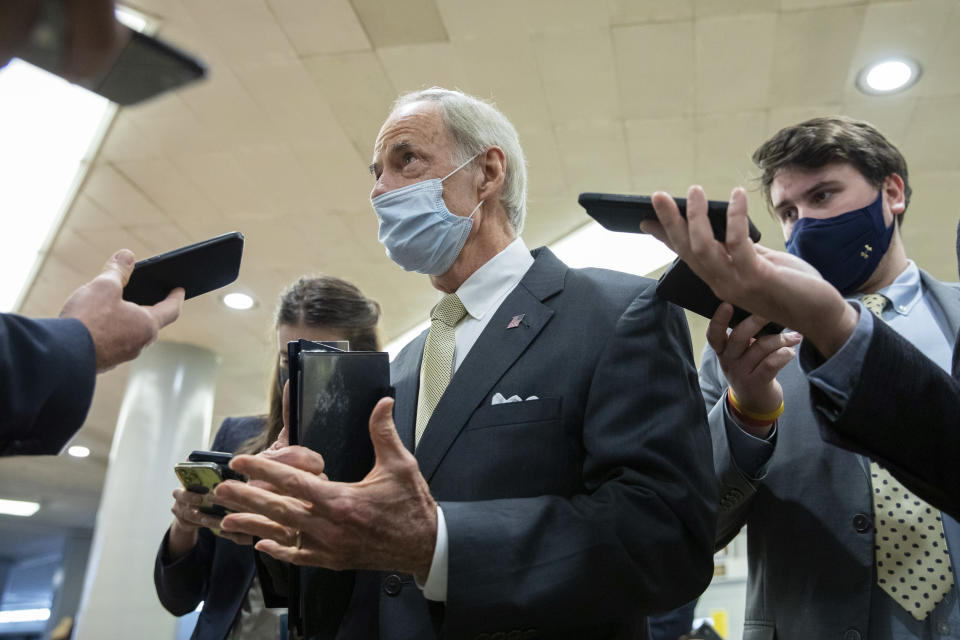 Sen. Tom Carper, D-Del., speaks to reporters amid continuing talks around the $1 trillion bipartisan infrastructure bill on Capitol Hill in Washington, Tuesday, Aug. 3, 2021. (AP Photo/Amanda Andrade-Rhoades)