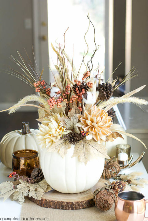 "<p>Put neutral colored blooms in a pumpkin vase and it instantly becomes a stunning Thanksgiving centerpiece.</p><p>See more at <a href=""http://apumpkinandaprincess.com/2015/09/diy-pumpkin-vase.html"" target=""_blank"">A Pumpkin and a Princess</a>.</p>"
