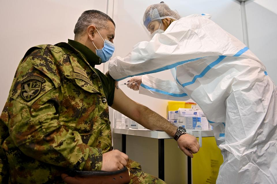 A Serbian army officer receives a dose of the Chinese-made Sinopharm vaccine at a newly established vaccination centre in Belgrade on January 19, 2021. - Serbia launched  a mass Covid-19 vaccination campaign and became the first European country to use Chinese-made Sinopharm vaccine, given to the country's health minister first. Serbia received on January 16, 2021 one million doses of the Sinopharm vaccine. (Photo by Andrej ISAKOVIC / AFP) (Photo by ANDREJ ISAKOVIC/AFP via Getty Images)