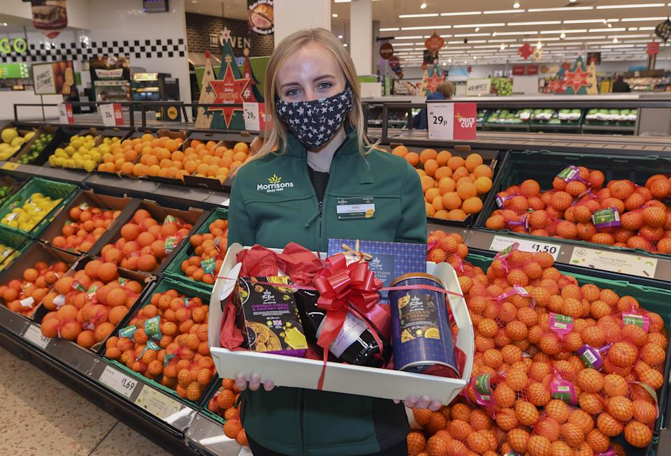 Staff member Sally O'Hara helps launch the Morrisons Acts of Community Kindness campaign. Photo: PA