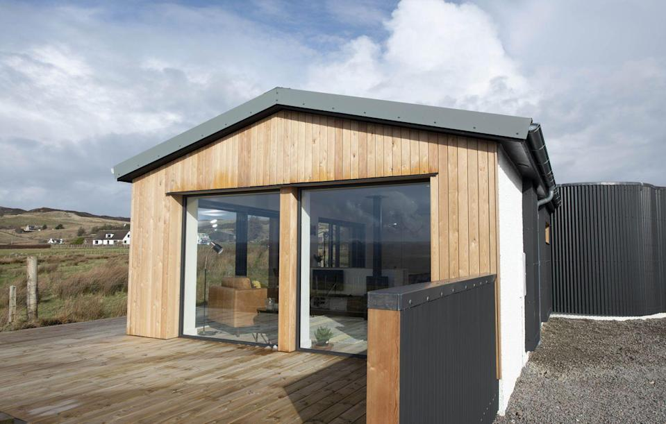 """<p>Possibly the breeziest log cabin we've ever seen, thanks to its lofty windows, Bliss Haus in the north-west of Scotland is also one of the most stylish (there's even a yellow Smeg fridge). The house sleeps four, with a king-size bed in the master bedroom and bunks next-door that children will love. Fresh seafood from the surrounding waters can be delivered for dinner parties that have a reclaimed-pine table, vintage leather chairs and a discoball as the backdrop. The cabin is on the shores of Loch Ewe, with Wester Ross, the Outer Hebrides and the Torridon Massif all making up the spectacular scenery. You'll be grateful for those windows.</p><p>From £900 a week, with <a href=""""https://www.coolstays.com/property/bliss-haus/21695"""" rel=""""nofollow noopener"""" target=""""_blank"""" data-ylk=""""slk:Cool Stays"""" class=""""link rapid-noclick-resp"""">Cool Stays</a>.</p>"""