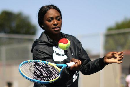 U.S. Open Champion Sloane Stephens teaches tennis to 400 elementary students at a workshop in Compton, California, U.S. April 12, 2018. REUTERS/Lucy Nicholson