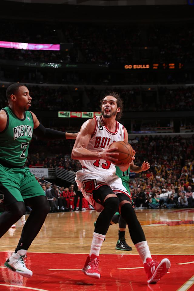 CHICAGO, IL - MARCH 31: Joakim Noah #13 of the Chicago Bulls handles the ball against the Boston Celtics on March 31, 2014 at the United Center in Chicago, Illinois. (Photo by Gary Dineen/NBAE via Getty Images)