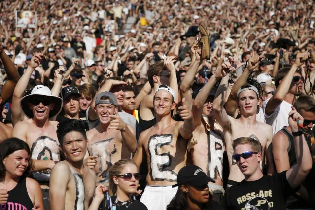 "WEST LAFAYETTE, IN – SEPTEMBER 23: <a class=""link rapid-noclick-resp"" href=""/ncaaf/teams/ppj"" data-ylk=""slk:Purdue Boilermakers"">Purdue Boilermakers</a> fans celebrate in the second quarter of a game against the <a class=""link rapid-noclick-resp"" href=""/ncaaf/teams/mmk"" data-ylk=""slk:Michigan Wolverines"">Michigan Wolverines</a> at Ross-Ade Stadium on September 23, 2017 in West Lafayette, Indiana. (Photo by Joe Robbins/Getty Images)"