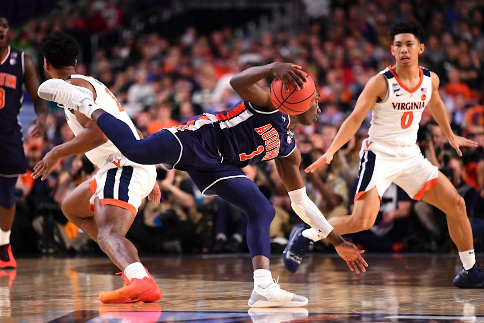 Jared Harper #1 of the Auburn Tigers drives against Kihei Clark #0 of the Virginia Cavaliers during the first half of the semifinal game in the NCAA Men's Final Four at U.S. Bank Stadium on April 06, 2019 in Minneapolis, Minnesota. (Photo by Brett Wilhelm/NCAA Photos via Getty Images)