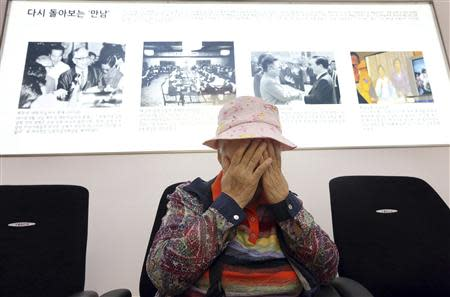 South Korean Cho, who was visiting to apply for additional application for inter-Korean family reunions, weeps at an office of the South Korean Red Cross in Seoul