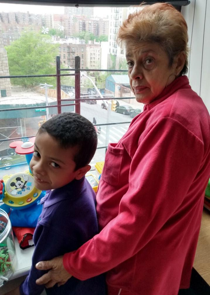 Image: Raynardo Antonio Ocasio and his grandmother, Ernestina Malave, who takes care of him in the mornings until his mother is home from work. (Family Handout)
