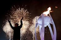 <p>Fireworks erupt as the cauldron is lit with the Olympic flame during the opening ceremony of the Pyeongchang 2018 Winter Olympic Games at the Pyeongchang Stadium on February 9, 2018. / AFP PHOTO / POOL / David J.PHILIP </p>