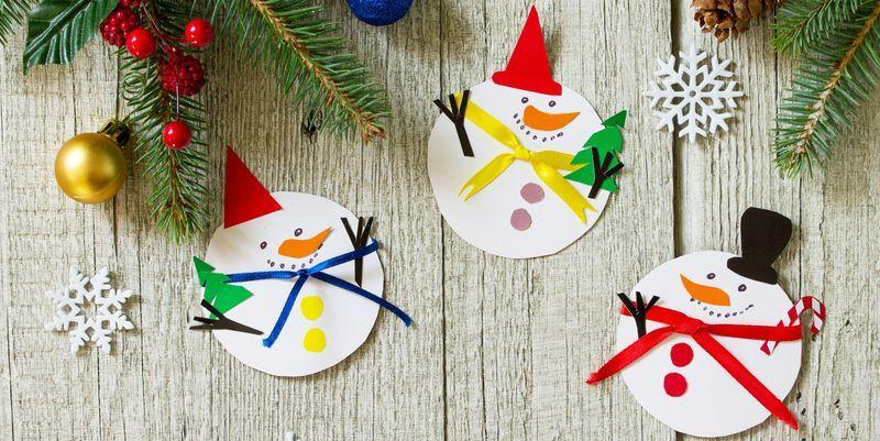"""<p>If your favorite winter fella happens to have a corncob pipe, a button nose, and two eyes made out of coal, you probably already have at least one snowman standing guard in your yard. But now you can bring Frosty inside—without getting melted snow all over the house—with our snowman craft ideas. We have <a href=""""https://www.countryliving.com/diy-crafts/how-to/g903/holiday-craft-projects-1209/"""" target=""""_blank"""">holiday craft projects</a> perfect for grown ups, and a few <a href=""""https://www.countryliving.com/diy-crafts/g5030/christmas-crafts-for-kids/"""" target=""""_blank"""">Christmas crafts for kids</a> for when it's too cold to play outside. </p><p>But these ideas aren't your the typical paper plate snowmen. Some, including the snowman candles, are a snap to create, while others, like the nifty snowman sign, take a little more DIY skill to make. The endearing snowmen bath bombs and a personalized snowman mug make especially great <a href=""""https://www.countryliving.com/diy-crafts/tips/g645/crafty-christmas-presents-ideas/"""" target=""""_blank"""">crafty Christmas present ideas</a>, but all are so...<em>cool</em> (sorry we couldn't resist) that once your friends and family see them they'll go straight to the top of their Christmas lists. So why not make a bunch of the following cute creations, like the lighted grapevine snowman wreath, no-sew sock snowman and and funky glitter snowman? Then just wrap and stack them under the tree. Everyone will be so glad you did!<br></p>"""