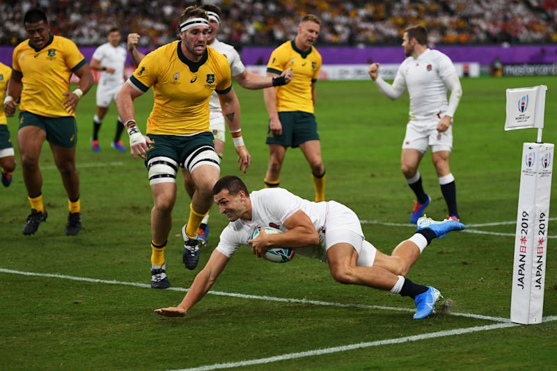 England's wing Jonny May scores a try during the Japan 2019 Rugby World Cup quarter-final match between England and Australia at the Oita Stadium in Oita on October 19, 2019. (Photo by CHARLY TRIBALLEAU / AFP) (Photo by CHARLY TRIBALLEAU/AFP via Getty Images)