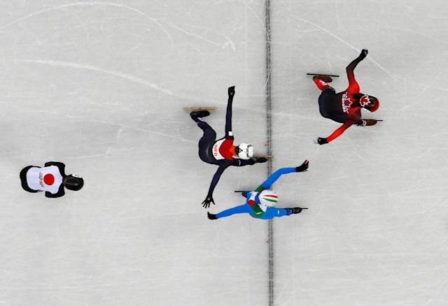 "Short Track Speed Skating Events - Pyeongchang 2018 Winter Olympics - Men's 1000m Quarterfinal - Gangneung Ice Arena - Gangneung, South Korea - February 17, 2018 - Samuel Girard of Canada crosses the finish line ahead of Yuri Confortola of Italy and Itzhak de Laat of Netherlands. REUTERS/Lucy Nicholson SEARCH ""OLYMPICS BEST"" FOR ALL PICTURES. TPX IMAGES OF THE DAY."