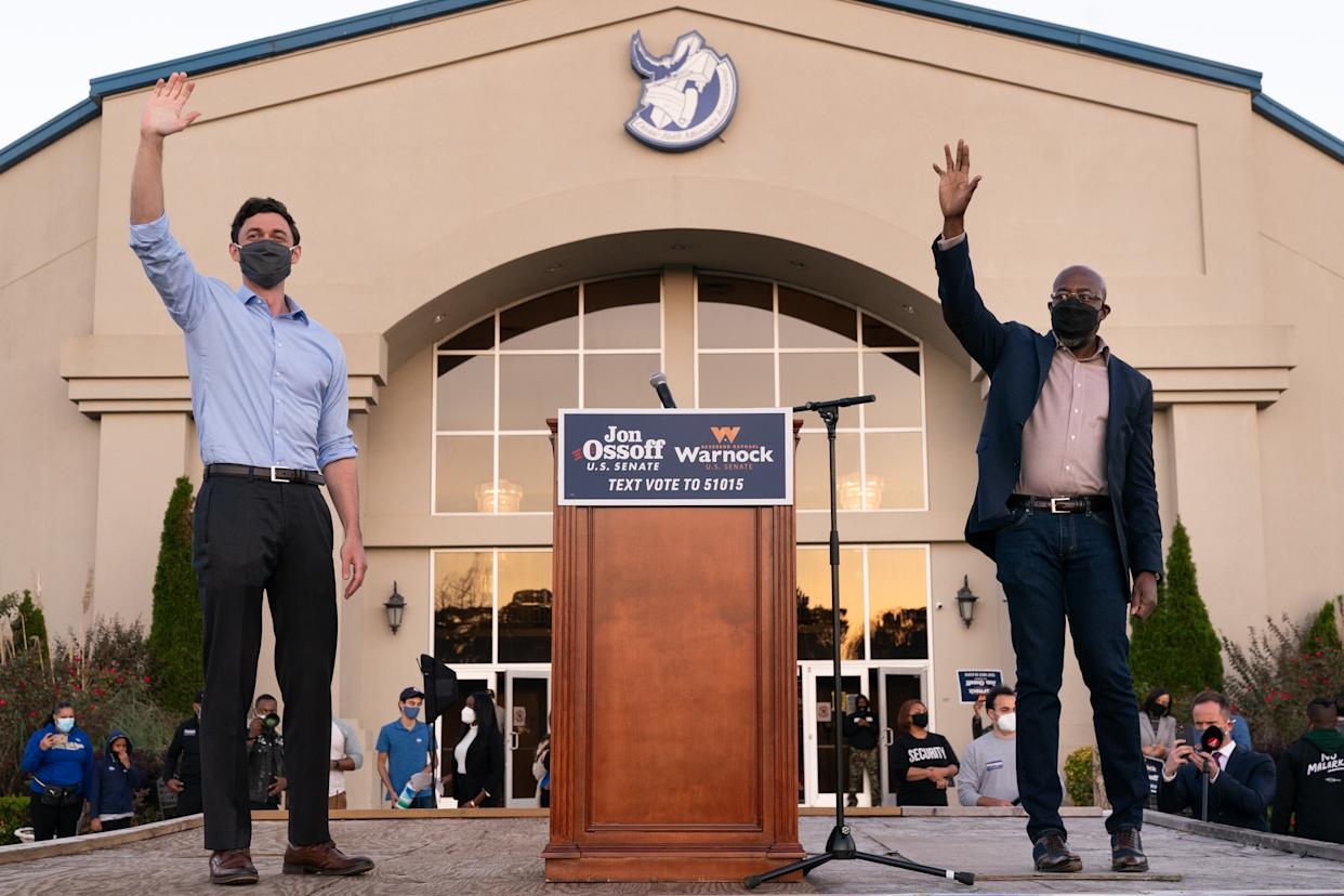 Democratic U.S. Senate candidates Raphael Warnock and Jon Ossoff are seen at a campaign event on November 19, 2020 in Jonesboro, Georgia. (Photo by Elijah Nouvelage/Getty Images)