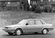 """<p>Launched late in the 1983 model year, the Camry served as a replacement for the Corona. That compact sedan, along with its smaller sibling, the Corolla, had helped Toyota become the top-selling import brand in the United States in the mid-1970s. Toyota used a new name, Camry—derived from the Japanese word <em>kanmuri</em>, meaning """"crown""""—to differentiate this new front-wheel-drive four-door sedan from the rear-wheel-drive model it replaced. The company considered its newest creation its first true entry into the compact-car segment, positioning the Camry against vehicles such as the Chevrolet Citation, Ford Tempo, Chrysler's K-cars, and, of course, the <a href=""""https://www.caranddriver.com/features/g15087327/hondas-accord-a-visual-history-of-the-best-selling-model-since-its-birth-in-1976/"""" rel=""""nofollow noopener"""" target=""""_blank"""" data-ylk=""""slk:Honda Accord"""" class=""""link rapid-noclick-resp"""">Honda Accord</a>. That last model would go on to become the Camry's closest rival.</p>"""