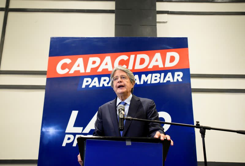 FILE PHOTO: Conservative Ecuadorean presidential candidate Guillermo Lasso addresses the media ahead of the February 7 presidential vote, in Guayaquil