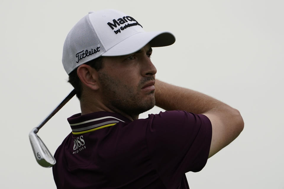 Patrick Cantlay watches his shot off the fourth tee in the third round at the Northern Trust golf tournament, Saturday, Aug. 21, 2021, at Liberty National Golf Course in Jersey City, N.J. (AP Photo/John Minchillo)