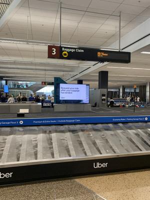 Digital signage at baggage claim reminds Sea-Tac travelers their ride is just a click away.