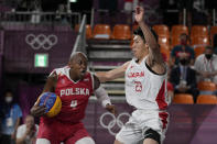 Poland's Michael Hicks (4) heads to the basket past Japan's Ryuto Yasuoka (23) during a men's 3-on-3 basketball game at the 2020 Summer Olympics, Saturday, July 24, 2021, in Tokyo, Japan. (AP Photo/Jeff Roberson)