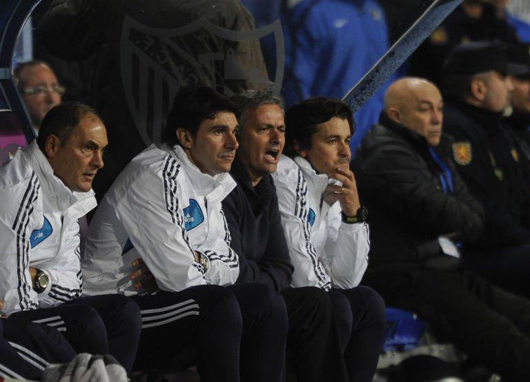 Real Madrid's Portuguese coach Jose Mourinho (2nd R) reacts during their match in Malaga on December 22, 2012