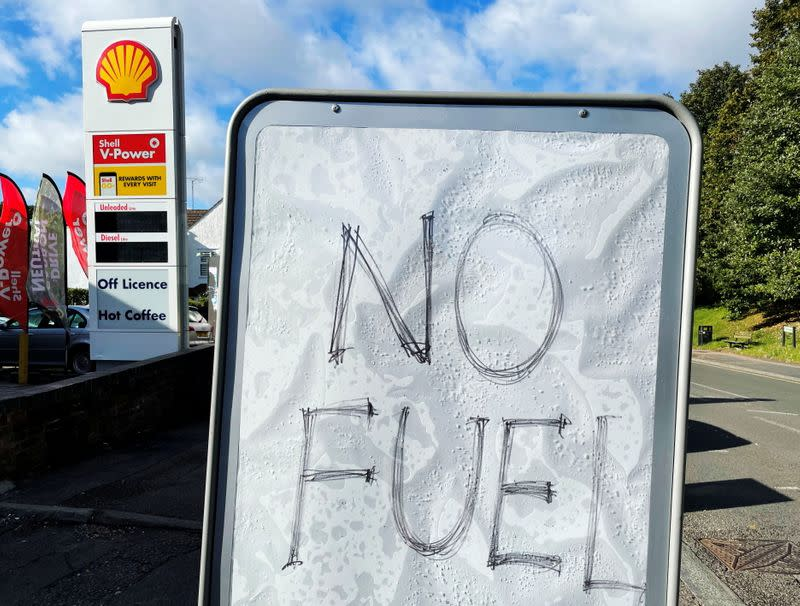 A sign showing customers that fuel has run out is pictured at a petrol station