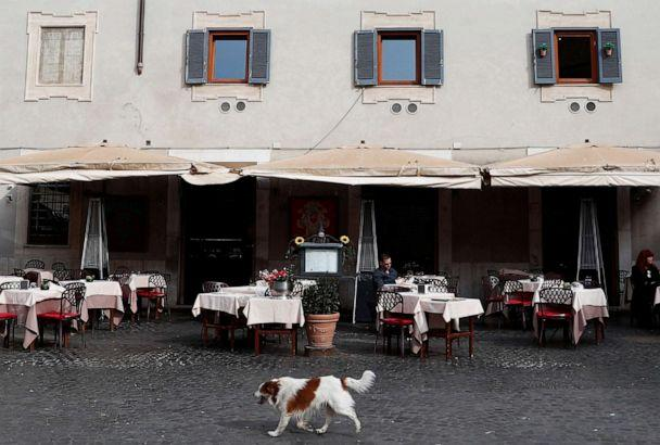 PHOTO: A dog passes in front of an empty restaurant after Italy was put on lockdown aimed at beating the coronavirus,in Rome, March 10, 2020. (Guglielmo Mangiapane/Reuters)