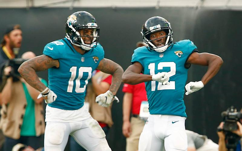 Jaguars wide receivers Donte Moncrief (10) and Dede Westbrook (12) celebrate a touchdown against the Patriots - USA TODAY Sports