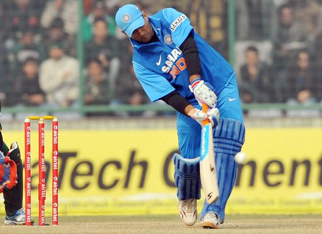 Indian Captain M S Dhoni hits for a six during the 3rd One Day Internationals Match between India & Pakistan at Ferozeshah Kotla Stadium in Delhi on January 6, 2013. P D Photo by Asish Maitra