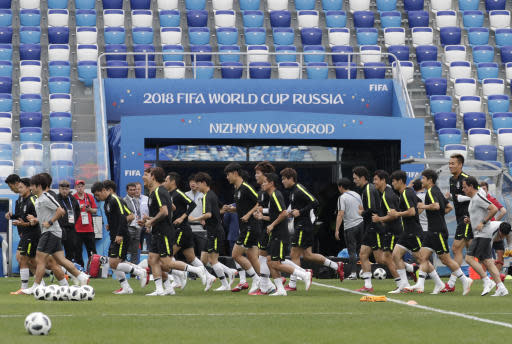 South Korea's national soccer team players run during South Korea's official training on the eve of the group F match between Sweden and South Korea at the 2018 soccer World Cup in the Nizhny Novgorod stadium in Nizhny Novgorod, Russia, Sunday, June 17, 2018. (AP Photo/Lee Jin-man)