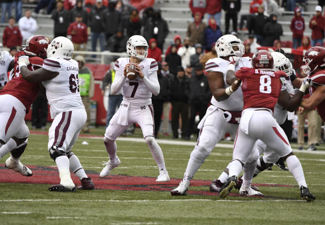"Mississippi State quarterback <a class=""link rapid-noclick-resp"" href=""/ncaaf/players/239230/"" data-ylk=""slk:Nick Fitzgerald"">Nick Fitzgerald</a> drops back top pass against Arkansas during the second half of an NCAA college football game Saturday, Nov. 18, 2017 in Fayetteville, Ark. (AP Photo/Michael Woods)"