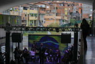 Musicians residents in the Paraisopolis favela, as part of the community's centennial celebration, in Sao Paulo, Brazil, Thursday, Sept. 16, 2021. One of the largest favela's in Brazil, home to tens of thousands of residents in the country's largest and wealthiest city, Paraisopolis is grappling with crime and a pandemic that have challenged daily life for many who live there, but organizers say its people have built a vibrant community and are launching a 10-day celebration of its achievements. (AP Photo/Andre Penner)