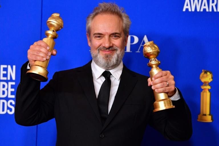 (FILES) In this file photo taken on January 5, 2020 British film director Sam Mendes poses in the press room with the awards for Best Director - Motion Picture and Best Motion Picture - Drama during the 77th annual Golden Globe Awards at The Beverly Hilton hotel in Beverly Hills, California