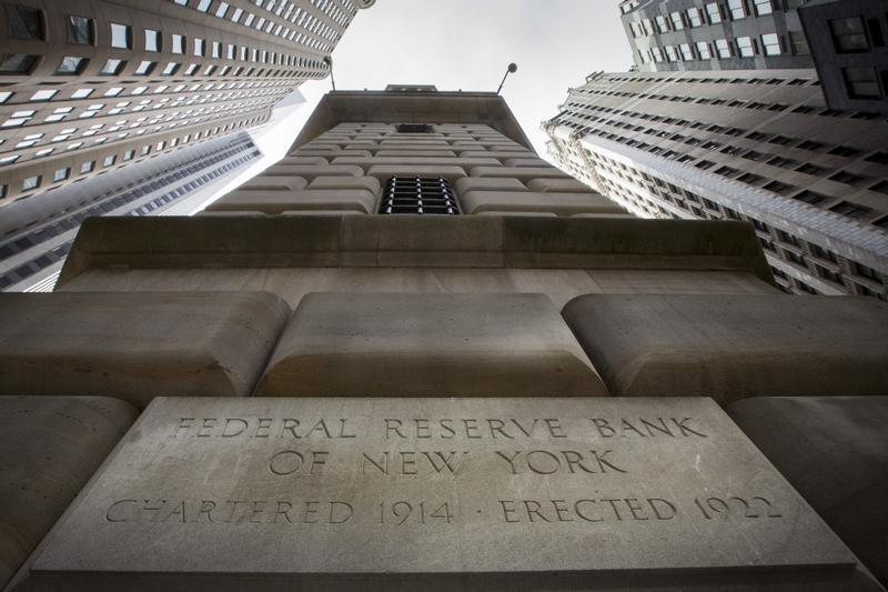 The corner stone of The New York Federal Reserve Bank is seen surrounded by financial institutions in New York's financial district
