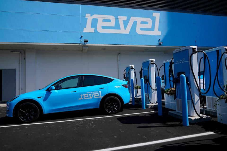 Chargers for electric cars are displayed at an opening ceremony for a Revel electric vehicle charging hub in the Brooklyn borough of New York, Tuesday, June 29, 2021. (AP Photo/Seth Wenig) ORG XMIT: NYSW102