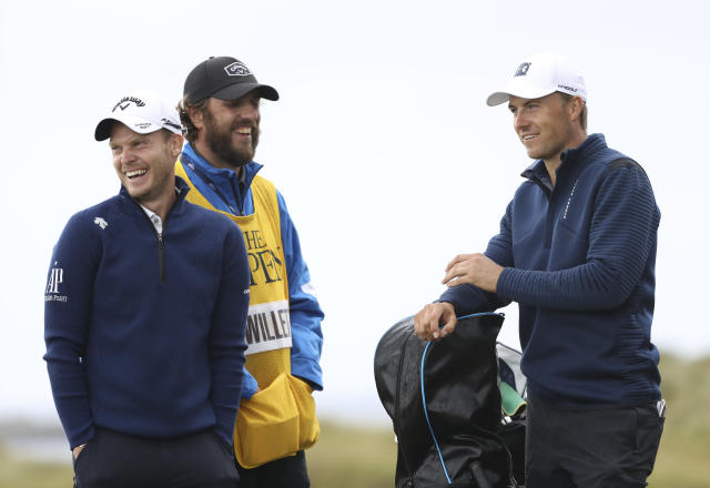 England's Danny Willett, left, smiles with Jordan Spieth of the United States as they wait to play on the 16th tee during the first round of the British Open Golf Championships at Royal Portrush in Northern Ireland, Thursday, July 18, 2019.(AP Photo/Peter Morrison)