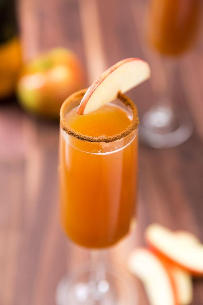 """<p>Whether you're toasting to fall or obsessed with apple cider, these mimosas are insanely delish.</p><p>Get the recipe from <a href=""""https://www.delish.com/cooking/recipe-ideas/recipes/a46963/apple-cider-mimosas-recipe/"""" rel=""""nofollow noopener"""" target=""""_blank"""" data-ylk=""""slk:Delish"""" class=""""link rapid-noclick-resp"""">Delish</a>. </p>"""