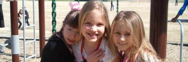 Yassy, Mackenzie, and Alyce as young children.