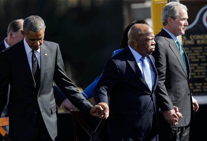 "President Barack Obama, Rep. John Lewis, and former President George W. Bush hold hands on March 7, 2015, during a ceremony marking the 50th anniversary of the ""Bloody Sunday"" events at the Edmund Pettus Bridge in Selma, Alabama. (Photo: ASSOCIATED PRESS)"