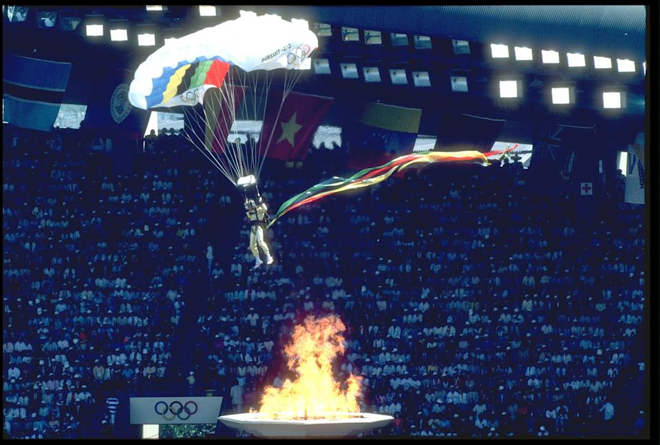 A stunt man with a parachute attempts to land in the Olympic stadium during the opening ceremony of the 1988 Summer Olympic Games in Seoul, South Korea on Sept. 17, 1988.