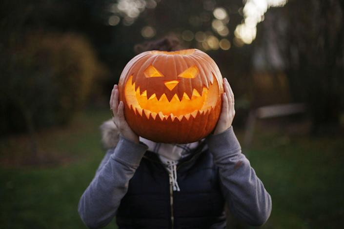 """<p>Irish Central details the myth of Stingy Jack, who was eternally doomed to roam the earth at night after making a deal with the devil. To guide his way, he lit a coal in a carved out turnip, <a href=""""https://www.irishcentral.com/roots/history/jack-o-lantern-turnips-ireland"""" rel=""""nofollow noopener"""" target=""""_blank"""" data-ylk=""""slk:inspiring Irish and Scottish people to do the same"""" class=""""link rapid-noclick-resp"""">inspiring Irish and Scottish people to do the same</a>. When they later immigrated to America however, they realized the native pumpkins there had a more ideal surface for carving.</p>"""
