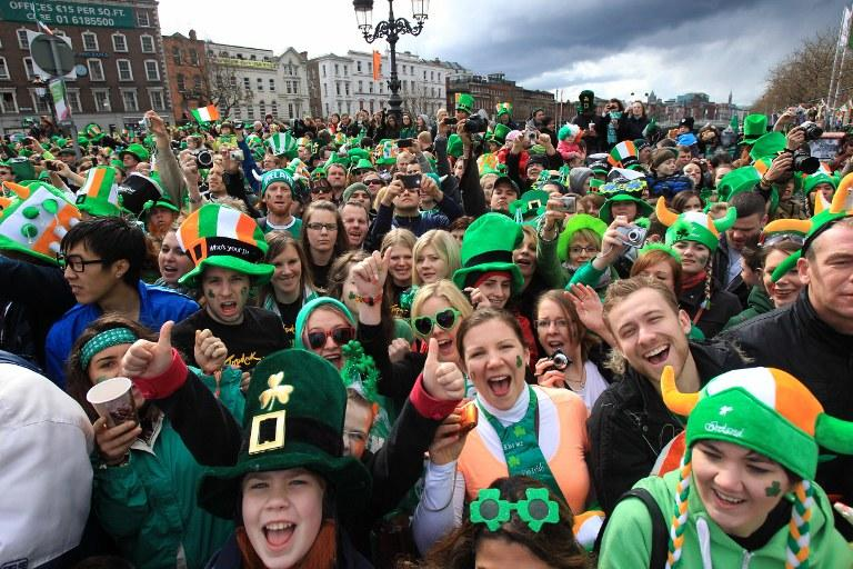 Parade goers shout as they watch St Patrick's Day festivities in Dublin, Ireland.