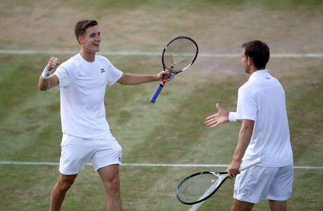 Joe Salisbury (left) and Frederik Nielsen celebrate winning ta match at Wimbledon in 2018