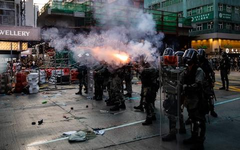 <span>Riot police fired tear gas and water cannon, drenching Hong Kong's biggest mosque with blue dye in what they said was an accident</span> <span>Credit: Kyle Lam/Bloomberg </span>