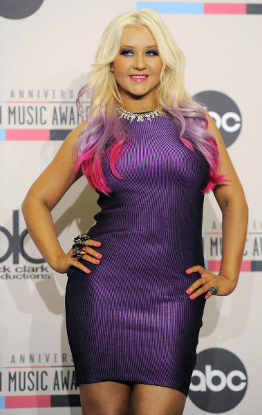 Singer Christina Aguilera poses after announcing the 2012 American Music Awards nominations at the J.W. Marriott L.A. Live on Tuesday, Oct. 9, 2012, in Los Angeles. The 40th Anniversary American Music Awards will be held on November 18 at the Nokia Theatre in Los Angeles. (Photo by Chris Pizzello/Invision/AP)