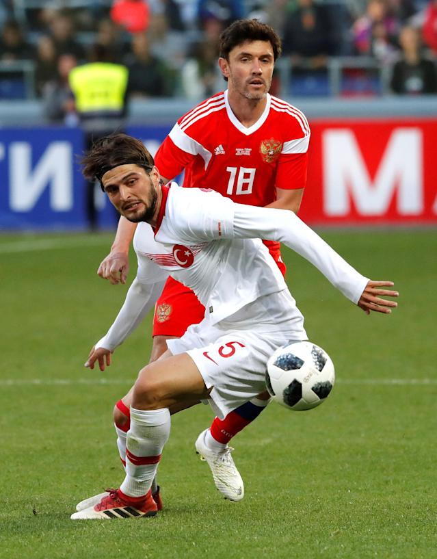 Soccer Football - International Friendly - Russia vs Turkey - VEB Arena, Moscow, Russia - June 5, 2018 Russia's Yuri Zhirkov in action with Turkey's Okay Yokuslu REUTERS/Sergei Karpukhin