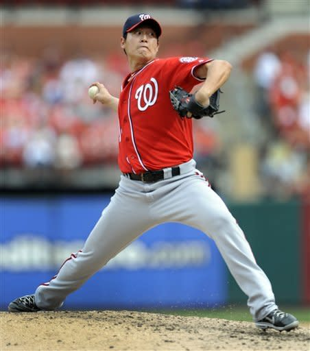 Washington Nationals pitcher Chien-Ming Wang, of Taiwan, throws during the fourth inning of a baseball game against the St. Louis Cardinals on Sunday, Sept. 30, 2012, in St. Louis. (AP Photo/Bill Boyce)