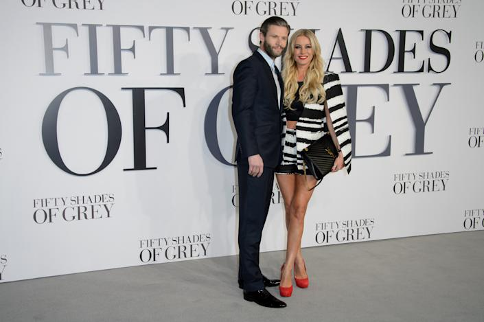 Denise Van Outen and Eddie Boxshall pose for photographers at the UK Premiere of Fifty Shades of Grey, at a central London cinema, Thursday, Feb. 12, 2015. (Photo by Jonathan Short/Invision/AP)